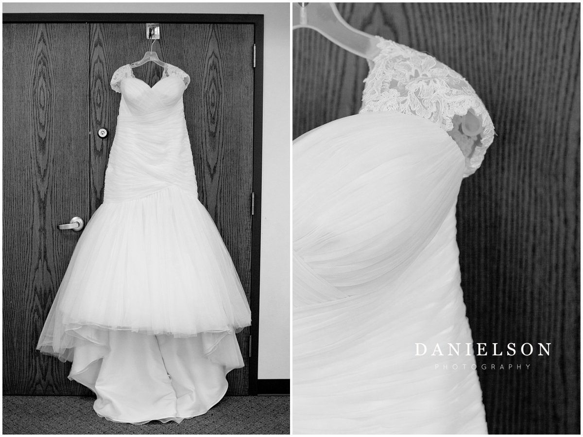 Photograph of white lace wedding gown hanging in Our Redeemer Lutheran Church in Waverly Iowa.