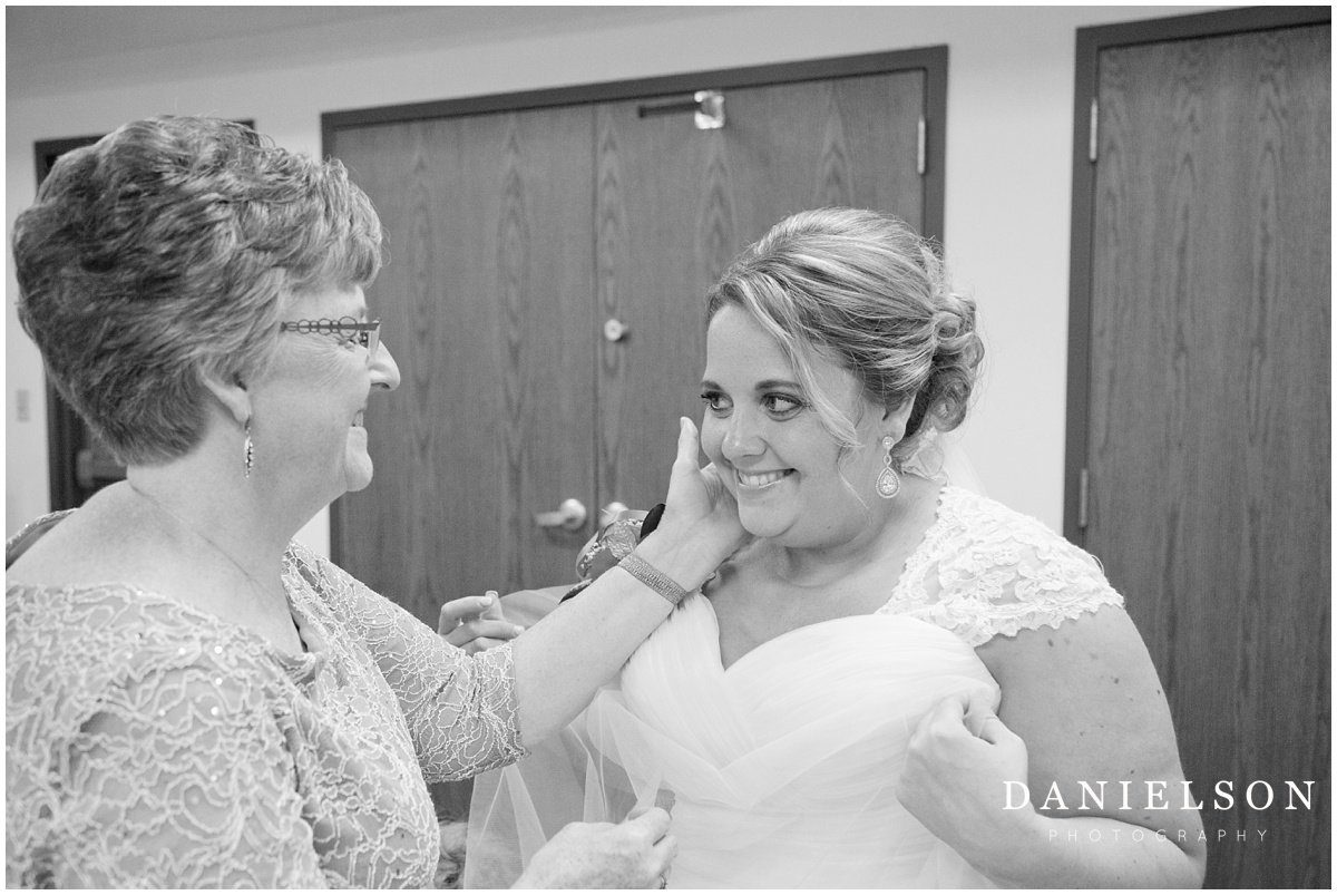 Waterloo IA wedding photographer photographing bride as she prepares for her ceremony at Our Redeemer Lutheran Church in Waverly Iowa.
